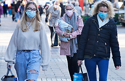 © Licensed to London News Pictures 05/02/2021.        Bexleyheath, UK. Shoppers wearing masks out and about on The Broadway in Bexleyheath, South East London today as the R-rate drops below 1 in England for the first time since July last year. Photo credit:Grant Falvey/LNP