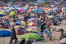 © Licensed to London News Pictures. 13/06/2021. London, UK. People bask in the sun at Margate Beach in Margate, Kent ahead of the Euro 2020 football match between England and Croatia. The UK is currently experiencing an extended hot weather period. Photo credit: Ray Tang/LNP