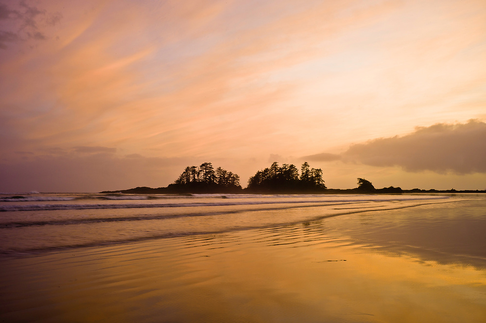 Sunset at low tide on South Chesterman's beach in Tofino, BC Canada.