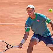 PARIS, FRANCE May 30. Kei Nishikori of Japan in action against Alessandro Giannessi of Italy in the first round of the Men's Singles competition on court fourteen at the 2021 French Open Tennis Tournament at Roland Garros on May 30th 2021 in Paris, France. (Photo by Tim Clayton/Corbis via Getty Images)
