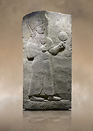 Photo of Hittite relief sculpted orthostat stone panel of Long Wall Basalt, Karkamıs, (Kargamıs), Carchemish (Karkemish), 900-700 B.C. Anatolian Civilizations Museum, Ankara, Turkey.<br /> <br /> Goddess Kubaba. Goddess is depicted from the profile. The part below the chest of the relief is broken. She holds a pomegranate in her hands on her chest. She carries a one-horned headdress on her head. Her braided hair hangs down to her shoulder. The text in the hieroglyphics is not understood. The lower part of the relief has been restored. <br /> <br /> On a brown art background. .<br />  <br /> If you prefer to buy from our ALAMY STOCK LIBRARY page at https://www.alamy.com/portfolio/paul-williams-funkystock/hittite-art-antiquities.html  - Type  Karkamıs in LOWER SEARCH WITHIN GALLERY box. Refine search by adding background colour, place, museum etc.<br /> <br /> Visit our HITTITE PHOTO COLLECTIONS for more photos to download or buy as wall art prints https://funkystock.photoshelter.com/gallery-collection/The-Hittites-Art-Artefacts-Antiquities-Historic-Sites-Pictures-Images-of/C0000NUBSMhSc3Oo