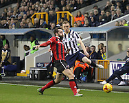 Shane Ferguson of Millwall and Gregg Wylde of Shrewsbury Town during the Sky Bet League 1 match at The Den, London<br /> Picture by Richard Brooks/Focus Images Ltd 07947656233<br /> 10/12/2016