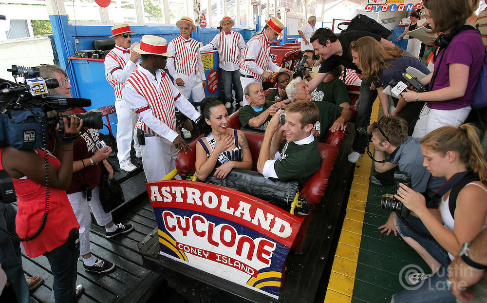 Angie Pantani (center L), also know as 'Miss Cyclone' is surrounded by reporters as she prepares to ride the Cyclone roller coater during the 80th anniversary celebration of the famous ride's first run in the Coney Island area of Brooklyn, New York on 26 June 2007.