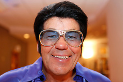 © Licensed to London News Pictures. 07/01/2012. BIRMINGHAM, UK.  Carl Curtis from Essex prepares to take part in the annual European Elvis Championship at the Hilton Metropole Hotel at the National Exhibition Centre today.  Photo credit: Alison Baskerville/LNP