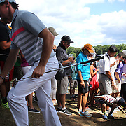 Rory McIlroy gives a young fan a ball after playing the fifth hole during the fourth round of theThe Barclays Golf Tournament at The Ridgewood Country Club, Paramus, New Jersey, USA. 24th August 2014. Photo Tim Clayton