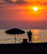 People On Tamarac Beach Watching The Sunset
