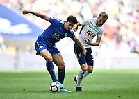 Football - 2017 / 2018 Premier League - Tottenham Hotspur vs. Leicester City<br /> <br /> Leicester City's Harry Maguire shields the ball from Tottenham Hotspur's Harry Kane, at Wembley Stadium.<br /> <br /> COLORSPORT/ASHLEY WESTERN