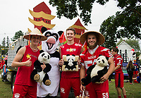 """Ryan Dee, Patrick Duggan and Tyler Richter with some """"Panda Power"""" (Mandy Stefanik) as they get ready to march with the Junior class during Laconia High School's Homecoming parade.  (Karen Bobotas/for the Laconia Daily Sun)"""