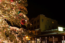 """""""Snowy Christmas Tree in Truckee 2"""" - This snow covered Christmas tree was photographed in Downtown Truckee, California with the Sierra Tavern in the background."""