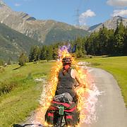Digitally enhanced Female cyclist on the Inn Route near Susch (or Sus) Zernez, Graubünden, Switzerland