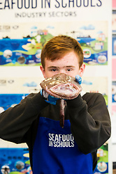 Pictured: Conneor Coulter (14) got to grips with a monkfish<br /> <br /> The Seafood in Schools project, which aims to teach children about Scottish seafood, visited Craigroyston Community High School today where 260 children took part in workshops with the opportunity to view and handle fresh and live species, including crab and lobster.<br /> Ger Harley | EEm 7 June 2016