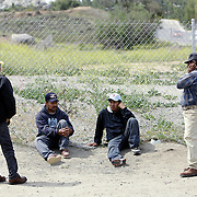 Day laborers gather in hopes of finding temporary work in San Diego, California. The migrant workers, mostly from Mexico, stand on street corners and in deserted lots where contractors and homeowners come looking for cheap labor. (Photo by Todd Bigelow/Aurora) Please contact Todd Bigelow directly with your licensing requests.
