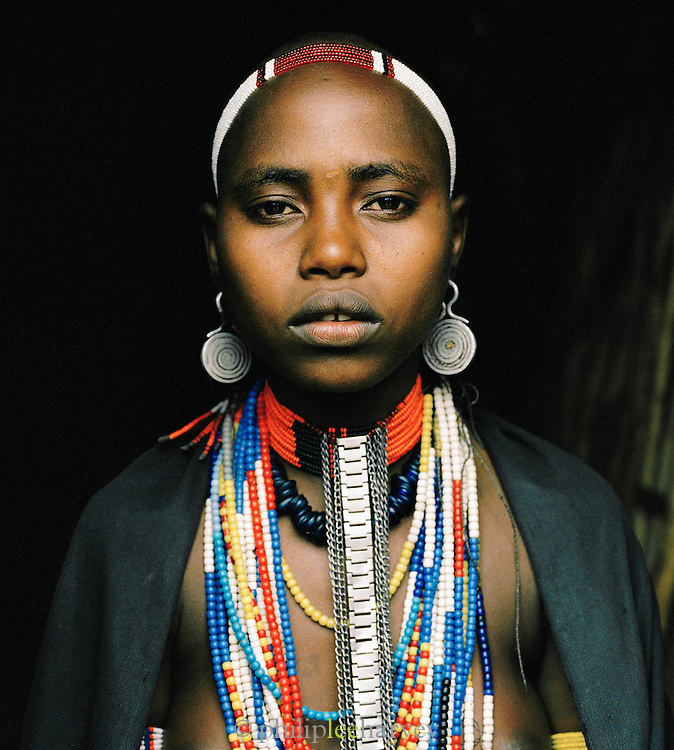 Portrait of Hamer tribeswoman wearing headgear in Turmi, Lower Omo Valley, Ethiopia