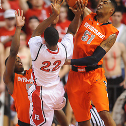 Rutgers Scarlet Knights forward Kadeem Jack (22) takes a shot past Syracuse Orange center Fab Melo's (51) block attempt during first half NCAA Big East basketball action between #2 Syracuse and Rutgers at the Louis Brown Athletic Center. Syracuse leads 40-34 at halftime.