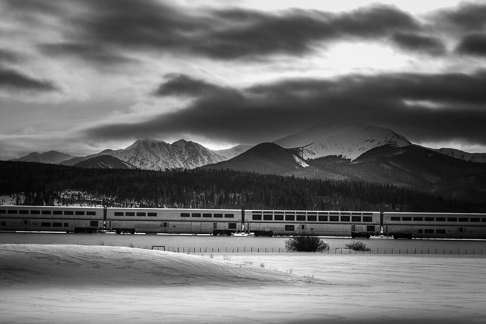 Amtrak's Califorina Zephyr travels east through the snow covered Rookie Mountains of Colorado.
