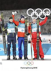 PYEONGCHANG, Feb. 15, 2018  Champion Norway's Johannes Thingnes Boe (C), second-placed Slovenia's Jakov Fak (L) and third-placed Austria's Dominik Landertinger pose for photos during venue ceremony of men's 20km individual event of biathlong at 2018 PyeongChang Winter Olympic Games at Alpensia Biathlon Centre, PyeongChang, South Korea, Feb. 15, 2018. (Credit Image: © Bai Xuefei/Xinhua via ZUMA Wire)