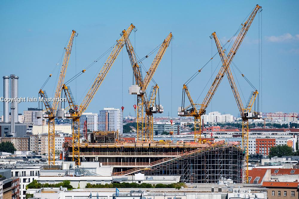 Skyline of Berlin looking towards tower cranes of construction site in Mitte, Berlin, Germany