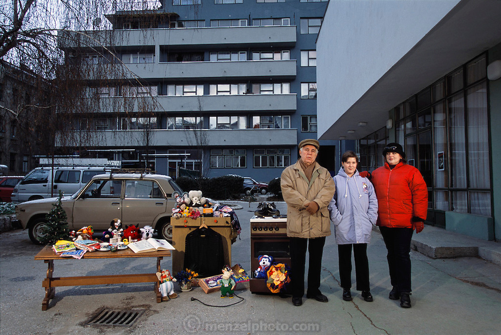 Portrait of the remaining Demirovic family members of Sarajevo, Bosnia & Herzegovina, 2001, with whatever new possessions they have acquired since the shooting of their portrait with all of their possessions for Material World: A Global Family Portrait.