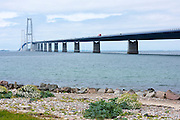 The Great Belt Bridge suspension bridge over Storebaelt joins Funen to Zealand viewed from Halskov, Denmark