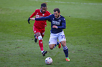 Football - 2020 /2021 Emirates FA Cup - Fourth Round : Millwall vs. Bristol City <br />  -  The Den<br /> <br /> Mason Bennett (Millwall FC) holds off the challenge of Kasey Palmer (Bristol City)<br /> <br /> COLORSPORT/DANIEL BEARHAM