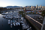 Downtown Vancouver and Granville Island (foreground) seen from Granville Bridge, at dusk.