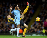 Gabriel Paulista of Arsenal tussles with Raheem Sterling of Manchester City during the English Premier League match at the Etihad Stadium, Manchester. Picture date: December 18th, 2016. Picture credit should read: Simon Bellis/Sportimage