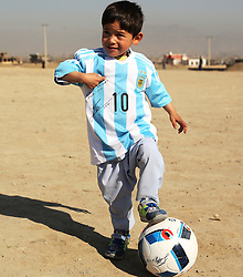 Afghan boy Murtaza Ahmadi poses for photos wearing a new jersey signed by Argentina soccer star Lionel Messi in Kabul, capital of Afghanistan, Feb. 26, 2016. Five-year-old Murtaza Ahmadi who became a social media hit after wearing a plastic bag bearing Lionel Messi's number 10 finally received the real thing which was sent by the Argentine footballer himself. EXPA Pictures © 2016, PhotoCredit: EXPA/ Photoshot/ Rahmat Alizadah<br /><br />*****ATTENTION - for AUT, SLO, CRO, SRB, BIH, MAZ only*****