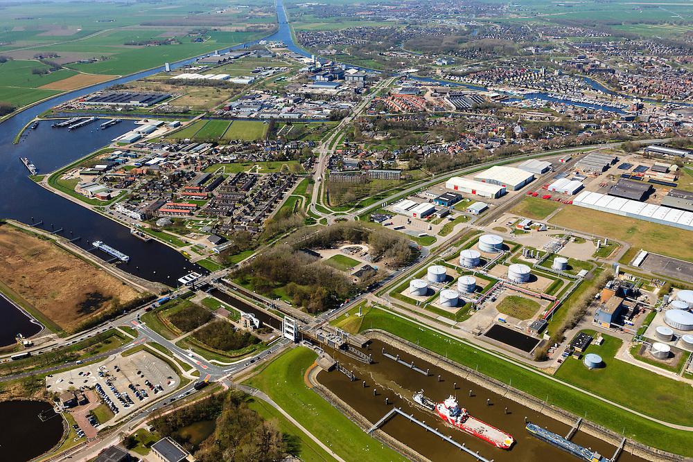 Nederland, Groningen, Delfzijl, 01-05-2013; Eemskanaal met de zeesluis in de voorgrond. Delfzijl in de achtergrond.<br /> De sluis maakt onderdeel uit van de vaarroute Lemmer-Delfzijl.<br /> Sealock of the Eemskanaal, the port of Delfzijl.<br /> luchtfoto (toeslag op standard tarieven);<br /> aerial photo (additional fee required);<br /> copyright foto/photo Siebe Swart