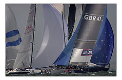 Americas Cup Jubilee, Team GBR getting round the Needles buoy among a cloud of sail...Marc Turner PFM Pictures