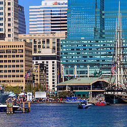 Baltimore, MD / US - October 15, 2016: The city's busy Inner Harbor with office nearby buildings.