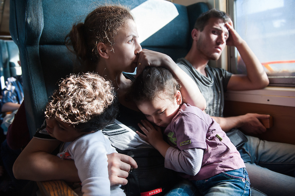 Noon, Sunday 13th of September 2015. Sham and Bisan sleep on Aysha's lap. They are on a special train just for refugees and immigrants from Gevgelija toSlanishte , across the Republic of North Macedonia. The train was packed,when Aysha got in. All the seats of the car were taken by young men from Iraq and Afghanistan. Aysha was displeased but she didn't protest. Somebody from the train said to a man to give his seat for Aysha, he did so reluctantly. There was no toilet on the train and no one had any idea were it goes or how long the journey will be.