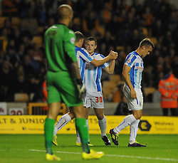 Huddersfield Town's Harry Bunn celebrates with his team mates after scoring. - Photo mandatory by-line: Dougie Allward/JMP - Mobile: 07966 386802 - 01/10/2014 - SPORT - Football - Wolverhampton - Molineux Stadium - Wolverhampton Wonderers v Huddersfield Town - Sky Bet Championship