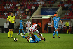 August 16, 2017 - Piraeus, Attiki, Greece - Carcela-Gonzalez (no 33) of Olympiacos tries to avoid Mate Males (no 26) of HNK Rijeka..Olympiacos manage to win 2-1 against HNK Rijeka in the first game for the UEFA Champions League play-offs, despite the fact that HNK Rijeka has achieved goal first. After this match the attention of the both team is going to focus to the rematch. (Credit Image: © Dimitrios Karvountzis/Pacific Press via ZUMA Wire)