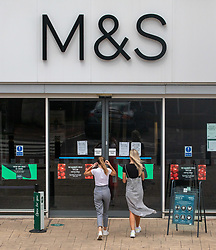 © Licensed to London News Pictures. 18/08/2020. London, UK. Members of the public shop at a M&S superstore in Merton high Street in South West London. M&S has announced that almost 7000 job will be cut across stores in the UK today. The high street chain announced the losses after being badly hit in the clothes sector during the retail slump due to the coronavirus crisis . Photo credit: Alex Lentati/LNP