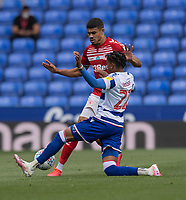 Middlesbrough's Ashley Fletcher (left) is tackled by Reading's Michael Olise (right) <br /> <br /> Photographer David Horton/CameraSport<br /> <br /> The EFL Sky Bet Championship - Reading v Middlesbrough - Tuesday July 14th 2020 - Madejski Stadium - Reading<br /> <br /> World Copyright © 2020 CameraSport. All rights reserved. 43 Linden Ave. Countesthorpe. Leicester. England. LE8 5PG - Tel: +44 (0) 116 277 4147 - admin@camerasport.com - www.camerasport.com