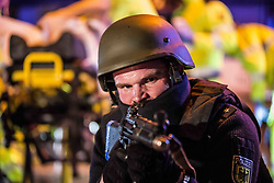 April 18, 2018 - Munich, Bavaria, Germany - During the night of April 17-18, the Munich Hauptbahnhof (train station) was closed for a large counter-terrorism training exercise, complete with the discharge of firearms, pursuits of suspects, and explosions.  The main exercise began at midnight and proceeded until 4am and was designed to simulate a terrorist commando unit attacking the Munich Central Station (Hauptbahnhof), which the anti-terrorism units were instructed to neutralize. Furthermore, emergency teams tended to injured victims.   (Credit Image: © Sachelle Babbar via ZUMA Wire)