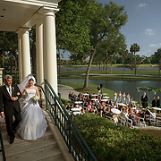 A father escorts his daughter down the stairs to her wedding ceremony at Osprey Point Golf Course on Kiawah Island. ©Travis Bell Photography