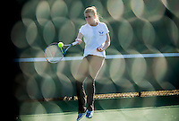 Gilford's Lindsey Corsack photographed through the fence during her singles match with Interlakes Caitly Curran Wednesday afternoon.  (Karen Bobotas/for the Laconia Daily Sun)