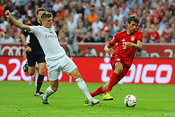 05.08.2015, Allianz Arena, Muenchen, GER, AUDI CUP, FC Bayern Muenchen vs Real Madrid, im Bild vl. Toni Kroos (Real Madrid) und Thomas Mueller (FC Bayern Muenchen) // during the 2015 Audi Cup Match between FC Bayern Munich and Real Madrid at the Allianz Arena in Muenchen, Germany on 2015/08/05. EXPA Pictures © 2015, PhotoCredit: EXPA/ Eibner-Pressefoto/ Stuetzle<br /> <br /> *****ATTENTION - OUT of GER*****