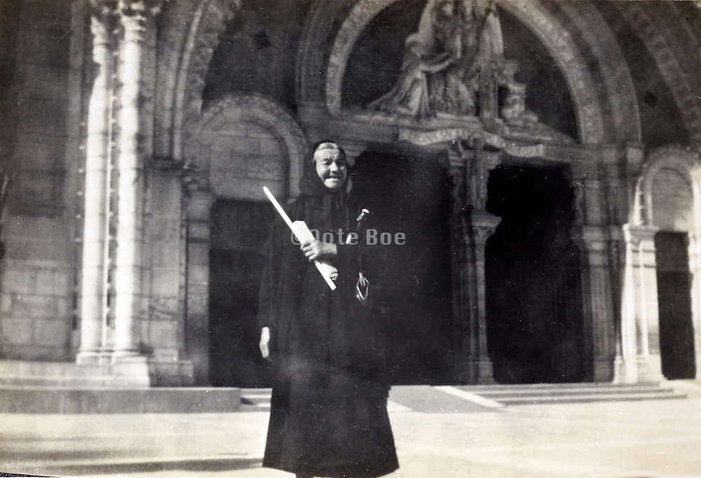 woman in black in front of a cathedral entrance France