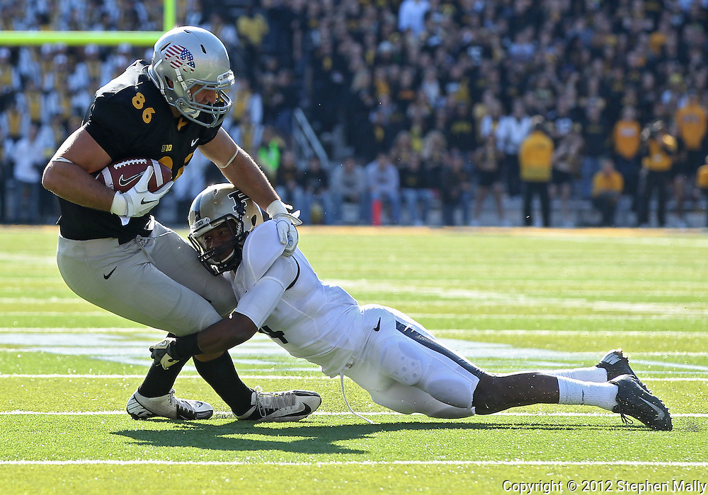 November 10 2012: Iowa Hawkeyes tight end C.J. Fiedorowicz (86) tries to pull away from Purdue Boilermakers defensive back Taylor Richards (4) during the NCAA football game between the Purdue Boilermakers and the Iowa Hawkeyes at Kinnick Stadium in Iowa City, Iowa on Saturday, November 10, 2012. Purdue defeated Iowa 27-24.