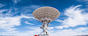 "Swirling cirrus cloud panorama. The Karl G. Jansky Very Large Array (VLA) is one of the world's premier astronomical radio observatories. Visit the VLA on the Plains of San Agustin fifty miles west of Socorro, between the towns of Magdalena and Datil, in New Mexico, USA. US Route 60 passes through the scientific complex, which welcomes visitors. The VLA is a set of 27 movable radio antennas on tracks in a Y-shape. Each antenna is 25 meters (82 feet) in diameter. The data from the antennas is combined electronically to give the resolution of an antenna 36km (22 miles) across, with the sensitivity of a dish 130 meters (422 feet) in diameter. After being built 1973-1980, the VLA's electronics and software were significantly upgraded from 2001-2012 by at least an order of magnitude in both sensitivity and radio-frequency coverage. The VLA is a component of the National Radio Astronomy Observatory (NRAO). Astronomers using the VLA have made key observations of black holes and protoplanetary disks around young stars, discovered magnetic filaments and traced complex gas motions at the Milky Way's center, probed the Universe's cosmological parameters, and provided new knowledge about interstellar radio emission. The VLA was prominently featured in the 1997 film ""Contact,"" a classic science fiction drama film adapted from the Carl Sagan novel, with Jodie Foster portraying the film's protagonist, Dr. Eleanor ""Ellie"" Arroway, a SETI scientist who finds strong evidence of extraterrestrial life. This panorama was stitched from 3 overlapping photos."