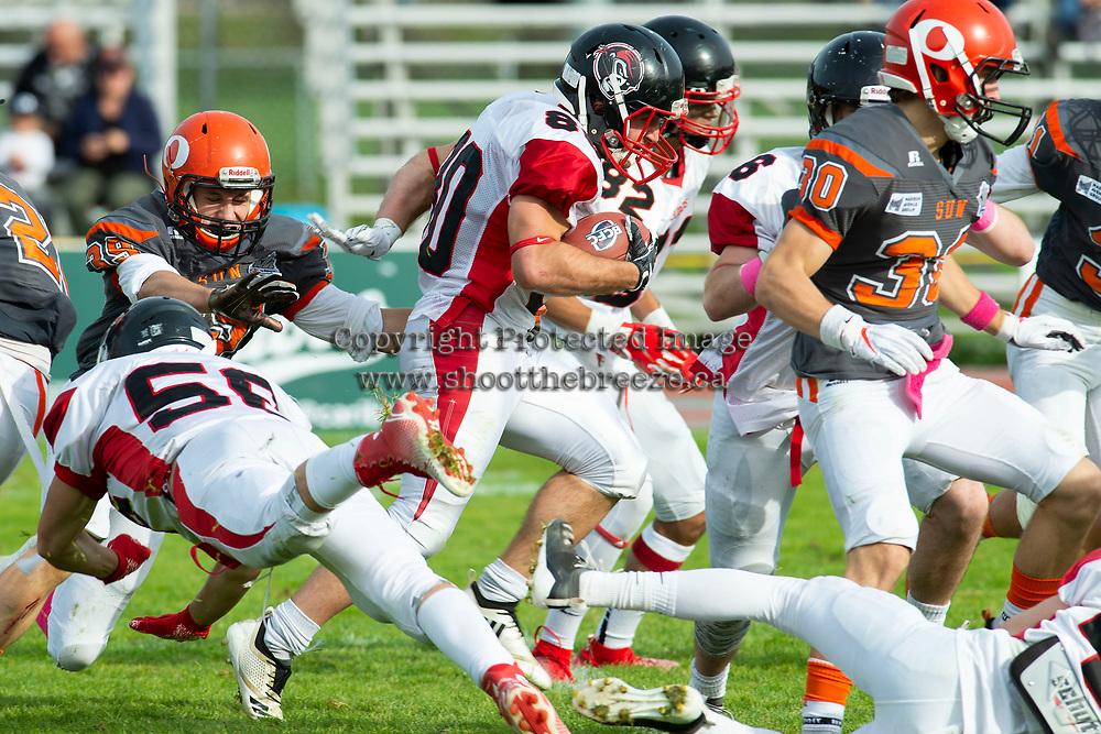 KELOWNA, BC - OCTOBER 6: Ethan Guilbault #39 of Okanagan Sun tries to tackle Jared Braun #80 of the VI Raiders at the Apple Bowl on October 6, 2019 in Kelowna, Canada. (Photo by Marissa Baecker/Shoot the Breeze)