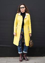Marta Peleteiro wears Dolce & Gabbana yellow coat during London Fashion Week Autumn/Winter 2017 in London.  Picture date: Friday 17th February 2017. Photo credit should read: DavidJensen/EMPICS Entertainment