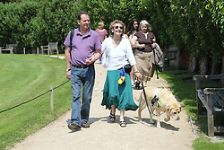 People with visual impairments in grounds of the Yorkshire Sculpture Park.