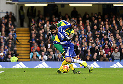 Diego Costa of Chelsea goes down under the challenge of Sebastien Bassong of Norwich City - Mandatory byline: Robbie Stephenson/JMP - 07966 386802 - 21/11/2015 - FOOTBALL - Stamford Bridge - London, England - Chelsea v Norwich City - Barclays Premier League