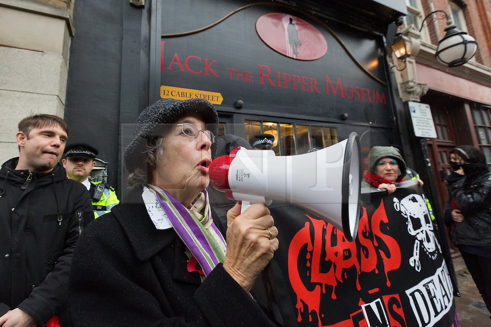 © Licensed to London News Pictures. 07/11/2015. London, UK. Eleanor Redshaw, the granddaughter of suffragette, Eleanor Higginson joins Class War and supporters to speak at a protest outside the Jack the Rippper Museum in Cable Street, Shadwell, east London. Protesters want to shut the museum down, accusing museum owner, Mark Palmer-Edgecumbe of glorifying rape and sexual violence against women. The original planning application for the museum submitted to Tower Hamlets council stated that it would celebrate the lives and history of east end women. This week a retrospective planning application for the museum sign and frontage was refused by the council.  Photo credit : Vickie Flores/LNP