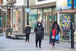 © Licensed to London News Pictures. 20/12/2020. <br /> Bromley, UK. A normally very busy Bromley High Street in Bromley, South East London looked deserted this morning on the last Sunday before Christmas day. All non-essential shops are closed due to the new tier four coronavirus restrictions put in place buy Prime Minister Boris Johnson yesterday. The Health Secretary Matt Hancock has warned London and the south East could be in Tier four for months. Photo credit:Grant Falvey/LNP
