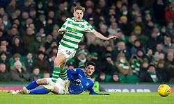 Celtic's James Forrest and St Johnstone's Scott Tanser battle for the ball during the Ladbrokes Scottish Premiership match at Celtic Park, Glasgow.