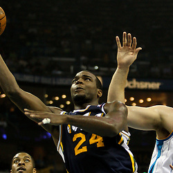 April 11, 2011; New Orleans, LA, USA; Utah Jazz power forward Paul Millsap (24) shoots over New Orleans Hornets center Aaron Gray (34) during the first half at the New Orleans Arena.  Mandatory Credit: Derick E. Hingle